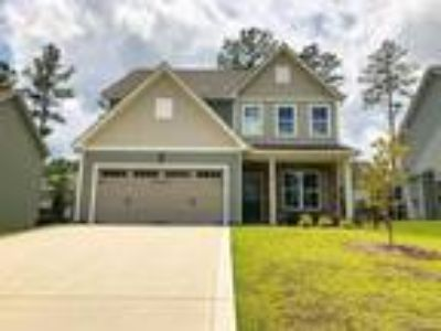 The Rockford by Wynn Homes is a Four BR hom...