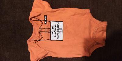 Six to nine-month onesie. Excellent condition