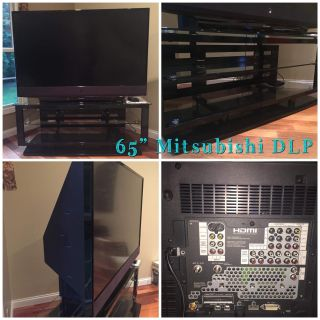 MOVING! - 65 Mitsubishi TV (DLP) Flat Screen 1070P, great picture. Stand included. Has multiple source hookups including HDMI