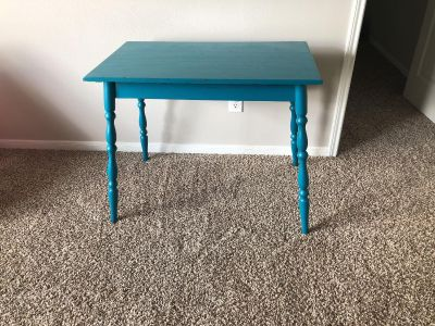Small table/desk could use some spray paint touch up.
