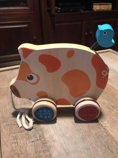Wooden pull pig toy