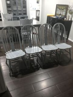 4 grey solid wood chairs.