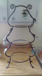 Beautiful wrought iron fruit display.4 pictures