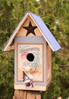 Beautiful bird House, made from Recycled wood and a Book
