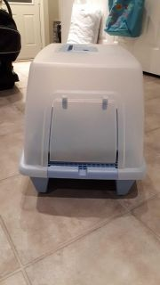 Cat litter box with mat for sale.