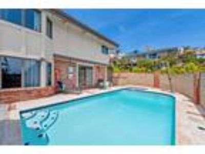 Spectacular fully furnished pool home is available for long or short term re...