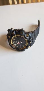 Smael black and gold muti function watch.