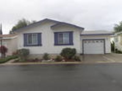 WB215JF MODEL HOME!! Three BR Two BA Manufactured Home With GARAGE, On Lake...
