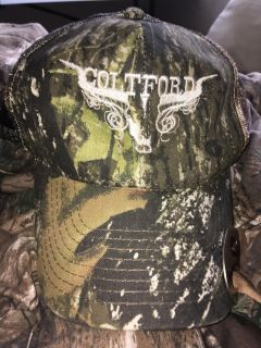 Colt ford hat with bottle opener attached