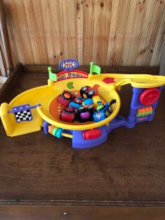 Fisher Price spinning race track toy