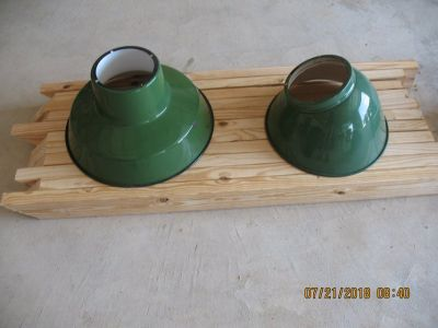 Two green vintage barn/gas station light fixtures