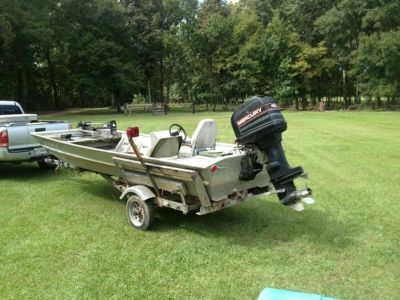 15 feet custom craft 48in wide  40 hp mercury Trailer  Needs new seats and some