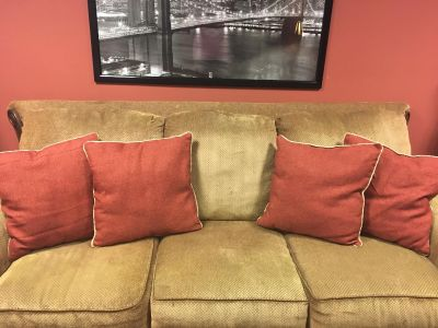 Terra-cotta throw pillows with piping