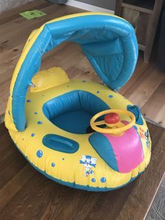 Infant swim float with canopy