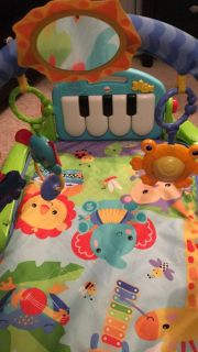 Fisher price play mat. Kick or sit piano
