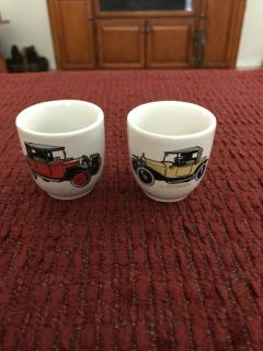 Vintage egg cups with antique cars pictured. England spelled on bottom. Minute chip on one. PPU only. Price is for both.