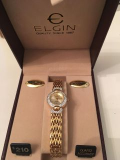 Elgin gold banded watch with faux diamond encrusted accents