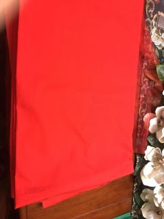 RED POLYESTER TABLE CLOTH.. Approx 95 x 56 Rectangle..