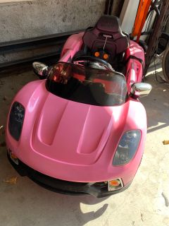 Kiddie roadster 12 V kids electric ride on car with R/C parental control/. Pink Porsche