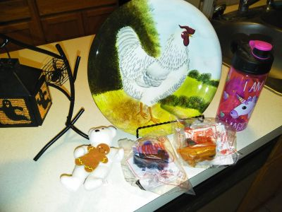 Stuff Holloween candle holder chicken olate with stand Unicorn water bottle and some McDonald's toys