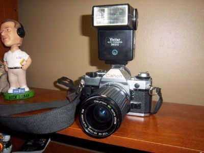 CANON AE-1 35MM SLR FILM CAMERA WITH 2 LENES AND BAG