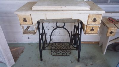 Helping Hand.... Antique sewing machine. Treadle
