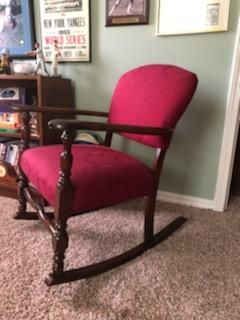 Cushioned antique rocking chair