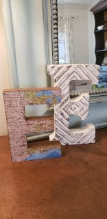 "Pair of Wood Letter E's. White E is 10"" T x 5.75"" W x 1.25"" D by Cynthia Rowley. Map Covered E is 8"" T x 5.5"" W x 1""D."