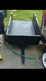 Towable dump cart. Newly refinished
