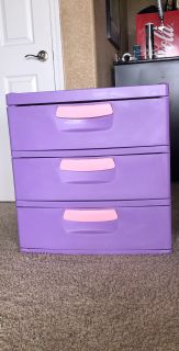 Fun plastic 3 shelved storage cabinet and matching rolling organizer.