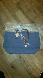Cute new with tags denim tote with long or short straps. Measures 12 x 21.