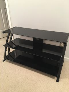 Black Tv stand with black tempered glass