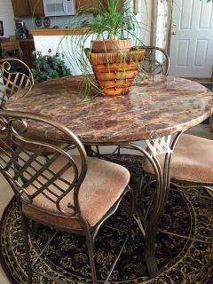 Marbletop dining table with four chairs