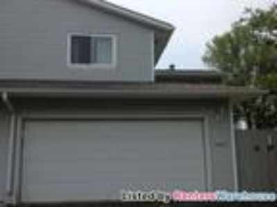 Available Now - Three BR Townhouse w/ 2 car garage