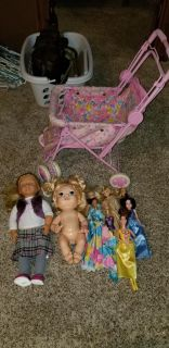 Stroller. My size doll, baby alive and 7 barbies selling as a group