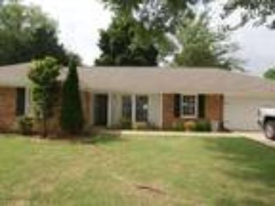 Beautifully updated Four BR home. New floors and fresh paint throughout!