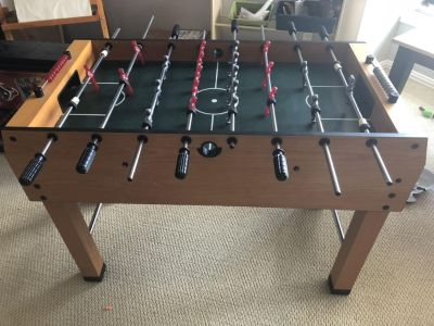 Like new Foosball Table with 9 balls.