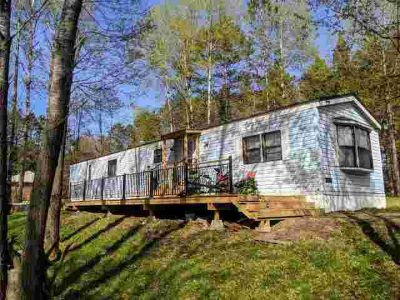N9091 down River Rd Phillips Two BR, Riverfront Opportunity!!
