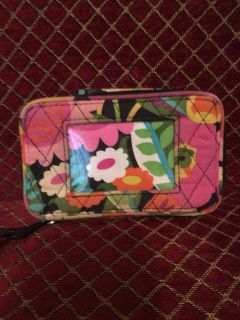 Vera Bradley Wallet. Outside has clear area for ID. Center zips open to hold credit cards and coins. Other side snaps open for additional