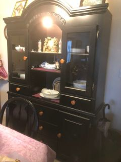 Beautiful black hutch with matching round table and four chairs