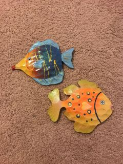 2 fish for wall. About 6x 6 inches each (maybe a bit larger). Yellow one has tiny chip (see pic). Porch pickup.