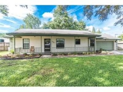 completely remodeled with an updated 3/4 bedrooms have brand new laminate flooring