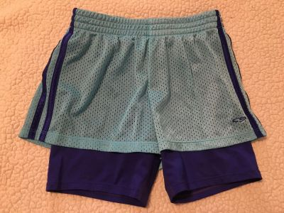 Girls champion brand athletic shorts with bicycle shorts attached underneath, guc size 10/12