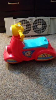 Fisher price scooter. Has different songs and learning modes. He had so many toys like this it was barely used.