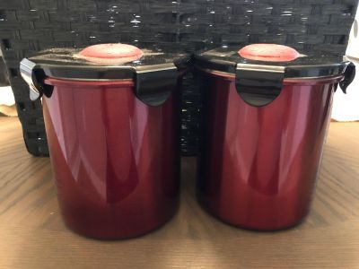Set of 2 red metal kitchen canisters