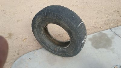ISO One 9.50/16.5 tire & One 245/75 R16 Tire