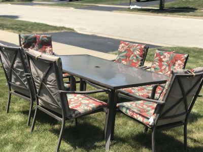 Nice large patio table with 6 chairs and cushions. $75 OBO