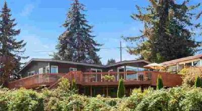 8516 S 112th St Seattle Four BR, Remodeled Mid-Century Home w/