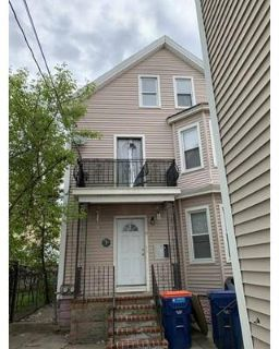 19 R Nye New Bedford Two BR, This 2 family with vinyl exterior