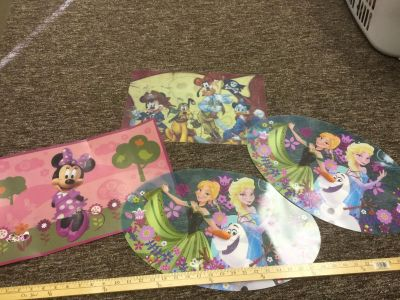 Set of 4 vinyl Disney placemats, 2 identical Frozen placemats, 1 Minnie, 1 Pirates of the Caribbean Mickey, some wear on pirate/ Minnie $2